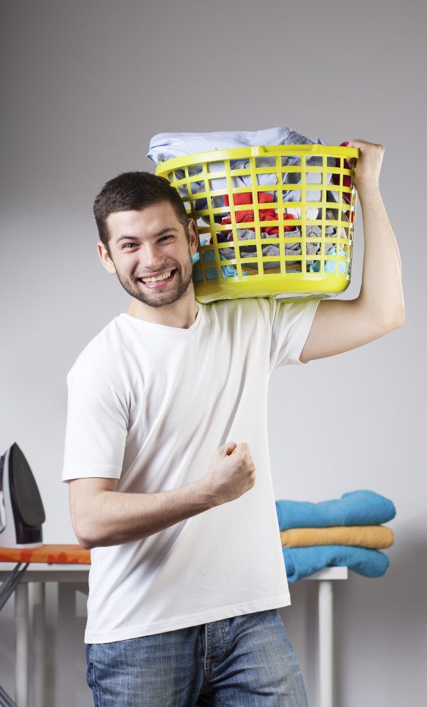 Man beeing proud because he just has done laundry by himself